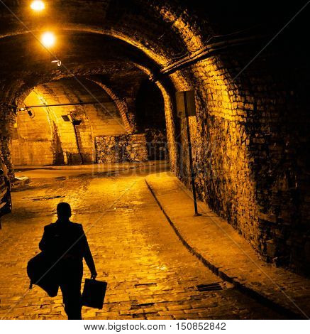 Person Walking Tunnels from the Silver Mines are Underground the Famous City of Guanajuato Mexico. Cars buses and people travel in the tunnels the