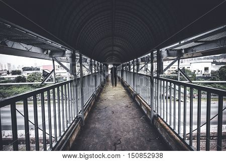 A perspective shot of a person walking at designated pedestrian crossing.