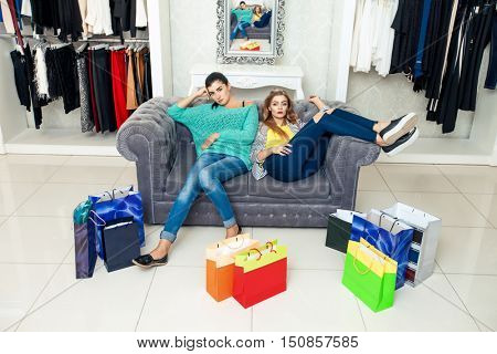 Women having rest after shoping