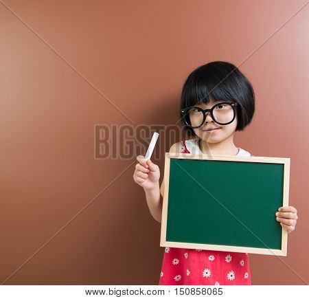 Asian School Kid With Chalk And Chalkboard