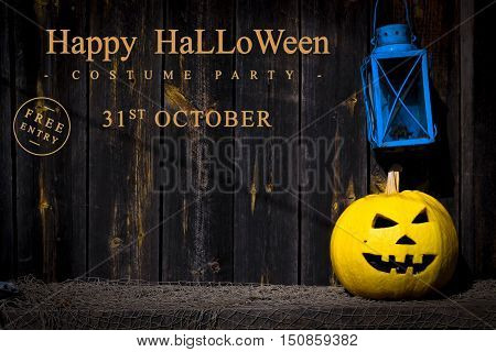 alloween. Scary pumpkin Jack-o-lantern and an old lantern on wooden background. Text Happy Halloween on October 31.The place to advertise.