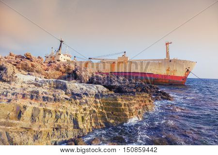 Seascape: boat  shipwrecked near the rocky shor. Mediterranean, near Paphos. Cyprus