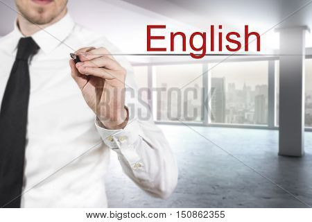 businessman translator in office writing english in the air