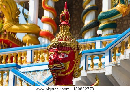 Hua Hin Thailand - Dec 28 2015: Head of Demon guardian statue sculpture at the entrance of Wat Etisukatow Buddhist temple