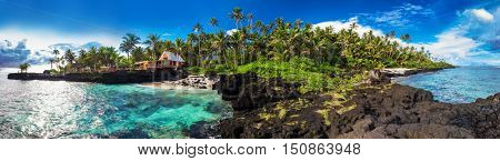 Panoramic view of coral reef and palm trees on south side of Upolu, Samoa Islands.