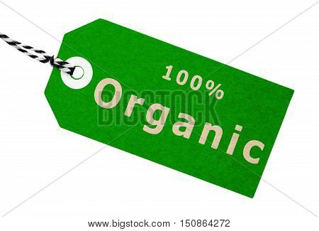 One hundred percent organic green cardboard label tag with string on an isolated white background with a clipping path