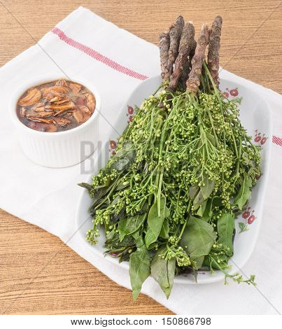 Thai Cuisine and Food Dish of Fresh Margosa or Neem Leaves and Blossom Served with Sweet Sauce.