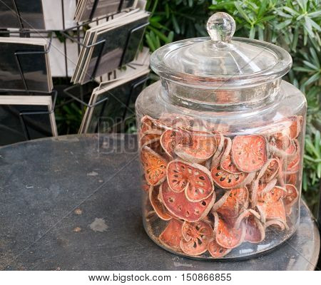 Vegetable and Herb Sliced and Dried Quince or Bael in Glass Jar Used for Quince Tea.