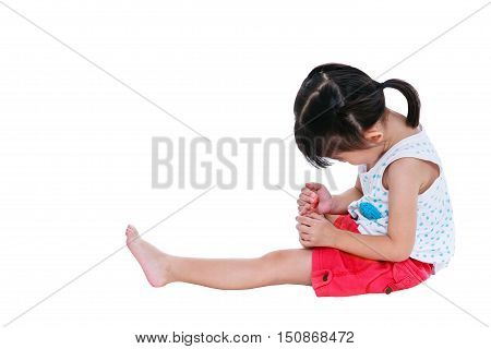 Asian Child Injured At Toenail. Isolated On White Background.