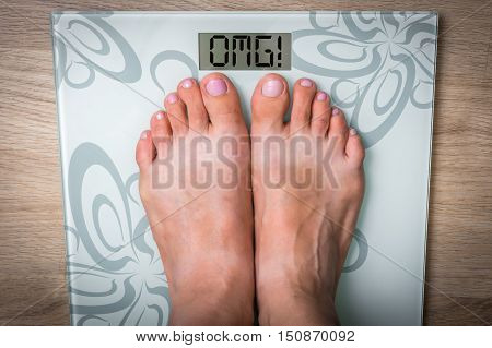 Woman's Feet On A Scale With Word Omg!