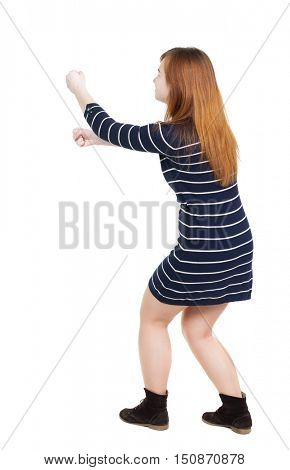 back view of standing girl pulling a rope from the top or cling to something. girl  watching. Rear view people collection.  backside view of person.  Isolated over white background. Sitting woman