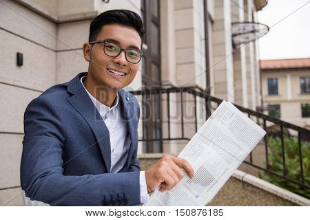 Asian Businessman With Paper In The Street