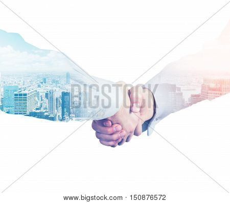 Close up of shaking hands. City view is seen at the background. Concept of meeting new business partners. Double exposure. Toned image. Mockup