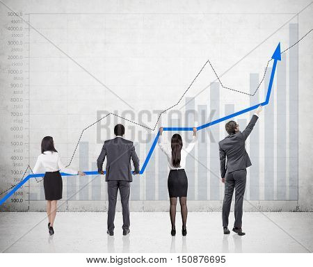 Rear view of four businesspeople holding blue graph near concrete wall with different graphs. Concept of forex. Mock up
