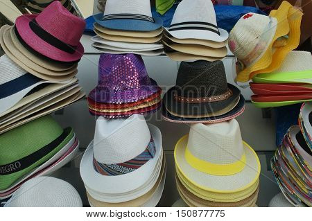 Colorful Straw Hats On The Street Sell Near The Sea