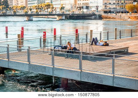Geneva, Switzerland - June 23, 2016: A terrace on pedestrian bridge with businessmen rest in the center of Geneva city. Geneva is a financial center and worldwide center for diplomacy in Europe