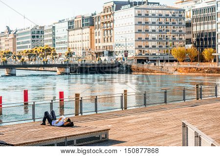 Geneva, Switzerland - June 23, 2016: A terrace on pedestrian bridge with businessman rest in the center of Geneva city. Geneva is a financial center and worldwide center for diplomacy in Europe