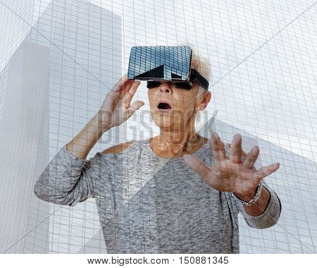senior woman with virtual reality headset is stunned by VR experience