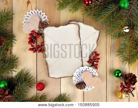 Christmas background in rustic style. Old paper for congratulations. / Santa wishes /. Top view. Natural decorations for a festive atmosphere. (Grandma knitted napkins to decorate the holiday table.) The family holiday.