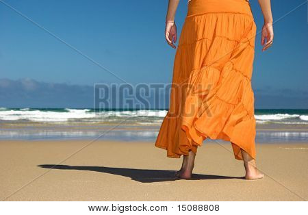 Alf woman with a orange skirt