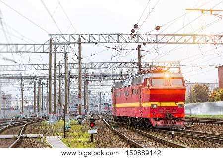 Old electric locomotiv rzd train rides on rails. Railroad tracks of technical railway station - operational locomotive depot. Transport infrastructure of Russian railways St. Petersburg