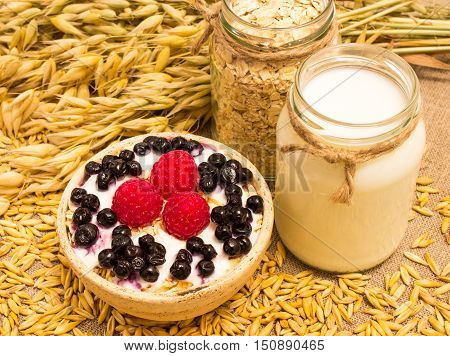 Oat Grain And Oatmeal With Fresh Fruits
