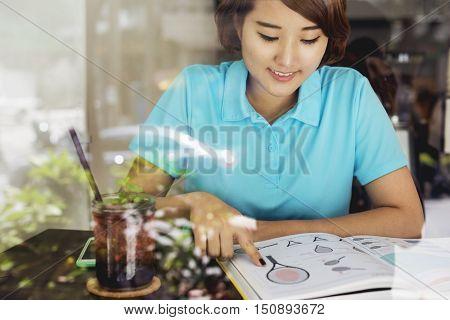 Asian Woman Reading Tennis Skills Book Concept