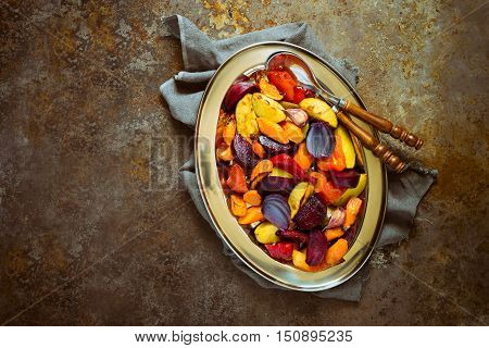 Roasted vegetables in a dish simple vegetarian comforting side dish good for Thanksgiving dinner or any event top view