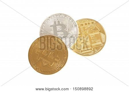 Three bitcoin coins gold silver and bronze isolated on white