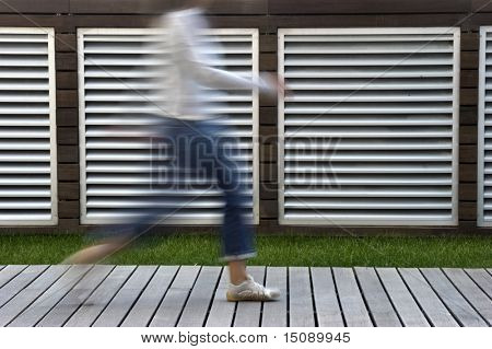 A motion blur abstract of a person walking in a hurry