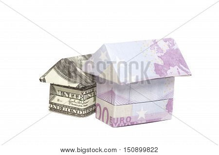 Origami house made of 500 euro and 100 dollar banknotes isolated on white background