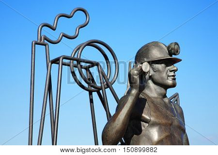 Cardiff, Wales, UK, September 14, 2016 :  From Pit to Port  sculpture by John Clinch and unveiled in 2005 which overlooks the Roath Basin in Cardiff Bay celebrating Welsh coal miners