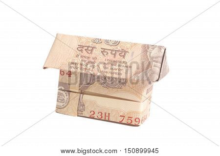 Origami Made of Indian rupee banknotes isolated on white background