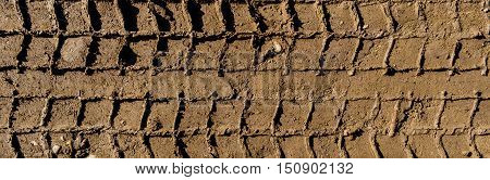 Tire tracks on the ground, texture of the soil, soil texture, nature background, ground, tire tracks, car tracks, ground texture