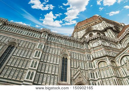 Florence Duomo under a blue sky with clouds Italy