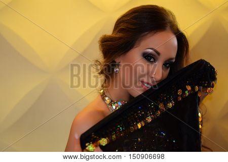 Beautiful belly dancer in interior, diamond bra and black skirt