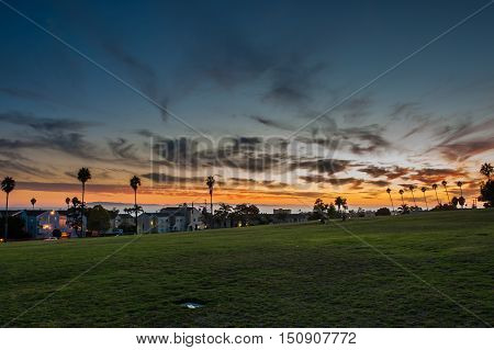 Ventura Cemetery Park sky shows afterglow and city lights at dusk.