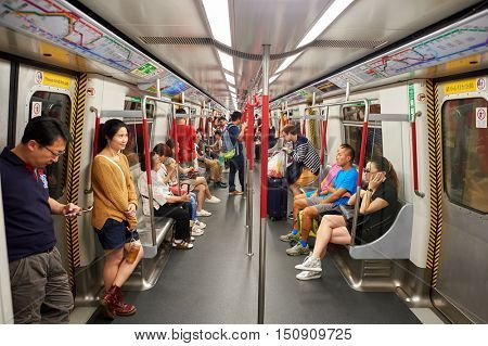 HONG KONG - OCTOBER 25, 2015: inside a MTR train. The Mass Transit Railway is the rapid transit railway system in Hong Kong. It is one of the most profitable systems in the world