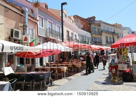 Cacilhas, Portugal - July 28, 2016:  Small Town Cacilhas in District Almada near Lisbon in Portugal. From here you can Start a Trip tot he Cristo Statue. A popular Place for Tourists and local People