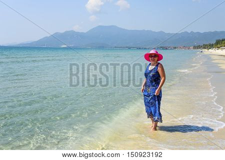Middle-aged woman on the Doc Let beach, Nha Trang, Vietnam