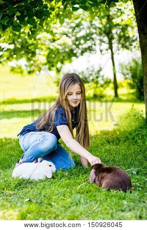 girl with a white rabbit. atractive girl with Easter bunny