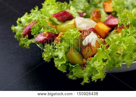 Salad.chorizo Sausage, Lettuce, Pickled Cucumber Fried Potato With Mayonnaise.dark Background