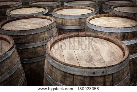 Barrels in the wine cellar background for your design