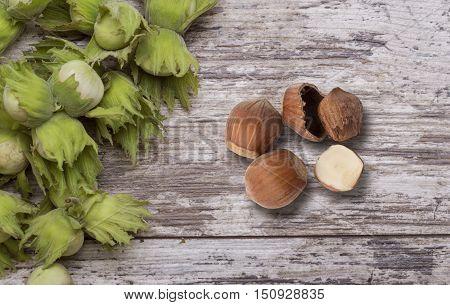 the green wild hazelnut on wooden table