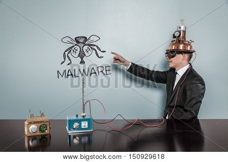 Malware concept with vintage businessman pointing hand