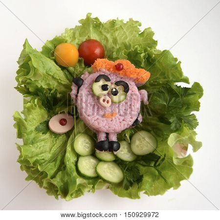 The cheerful pig is made of rice. The pig holds balls. Ridiculous food for good mood and appetite