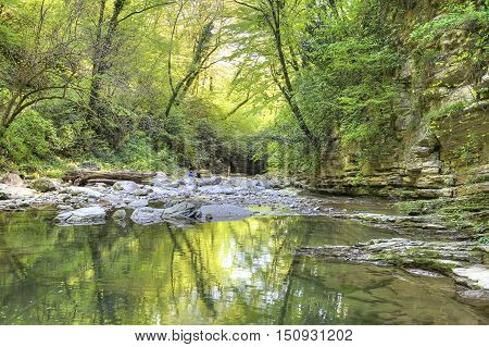 Mountain small river Agura in an of the same name canyon
