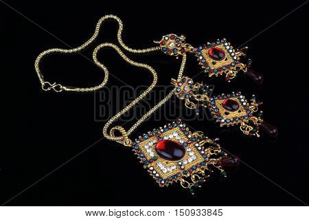 Intricate Indian Gold Jewelry On Black Background