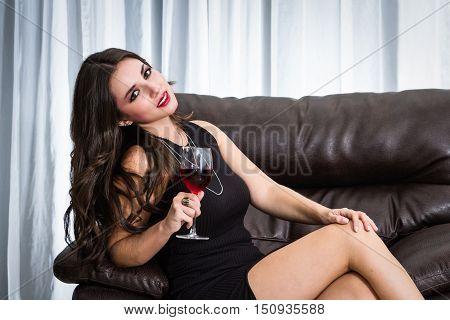 Seductive Brunette In A Black Dress