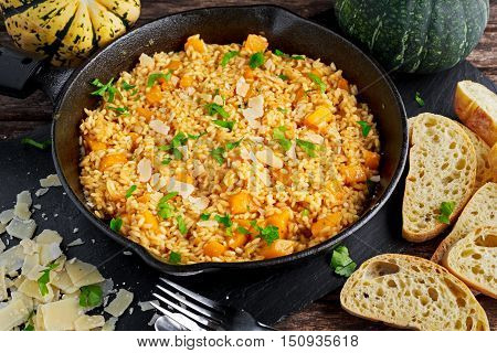 Pumpkin risotto in iron pan with Parmesan cheese, bread